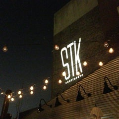 Photo taken at STK Rooftop by Dimi B. on 9/12/2013