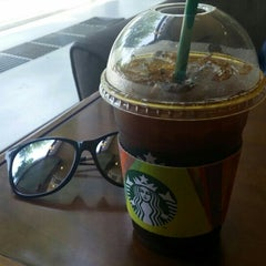 Photo taken at Starbucks by hyun-young C. on 5/21/2015