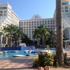 Photo taken at RIU Palace Pacifico Hotel by Martell G. on 10/7/2012