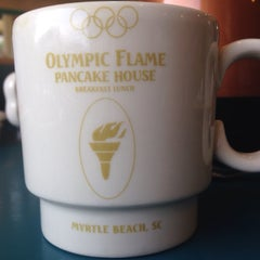Photo taken at Olympic Flame Pancake House by Erica R. on 8/23/2015