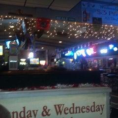 Photo taken at Gators Wing Shack by Richard S. on 12/26/2012