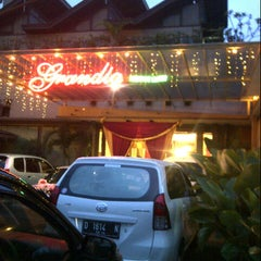 Photo taken at Grandia Resto Café & Pastry by Nefrand L. on 10/7/2012