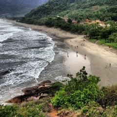 Photo taken at Praia de Guaecá by Pedro C. on 1/4/2013