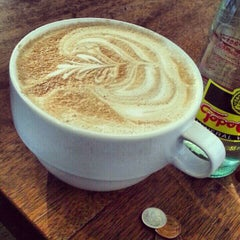 Photo taken at Halcyon Coffee, Bar & Lounge by Kris C. on 2/17/2013