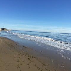 Photo taken at Isla Vista Beach by İrem Y. on 12/8/2014