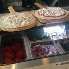 Photo taken at Pieology Pizzeria by Neal G. on 3/20/2013