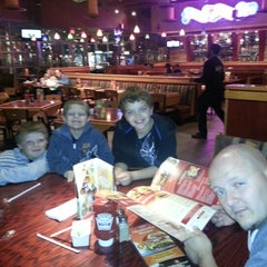 Photo taken at Red Robin Gourmet Burgers by Dejai T. on 10/19/2012