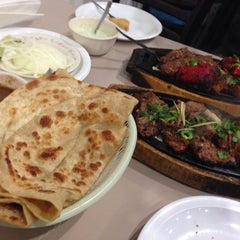 Photo taken at Delhi Darbar Kabab House by Monica L. on 1/19/2014