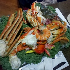 Photo taken at Bob Chinn's Crab House by Mio O. on 6/27/2013