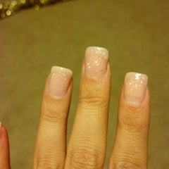 Photo taken at Attractive Nails & Spa by Alexandria B. on 12/1/2012