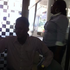 Photo taken at Africell  - Garden City by Allans on 3/5/2015
