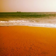 Photo taken at Kollam Beach by Xavier R. on 2/27/2014