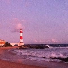 Photo taken at Praia de Itapuã by Rodrigo V. on 12/2/2012