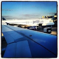 Photo taken at Gate 20 by E. J. W. on 2/12/2013
