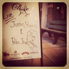 Photo taken at Olive Black Martini and Wine Lounge by Justin Y. on 3/22/2014