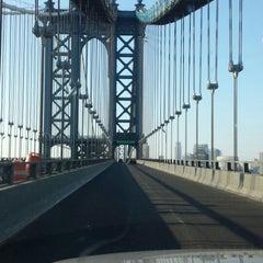 Photo taken at Manhattan Bridge by Eve Y. on 7/27/2013
