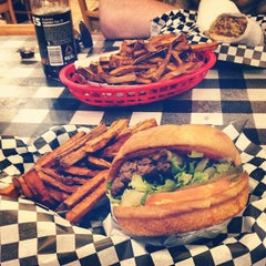 Photo taken at Wholly Cow Burgers by Tom S. on 2/11/2013