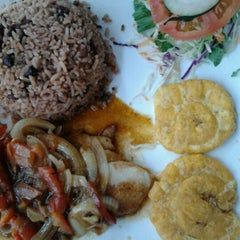 Photo taken at Guilligans Caribbean Food by Syl J. on 11/30/2012