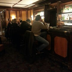 Photo taken at Bar du Lutetia by Ouchan S. on 12/19/2013