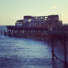 Photo taken at Hastings Pier by Kat P. on 1/1/2013