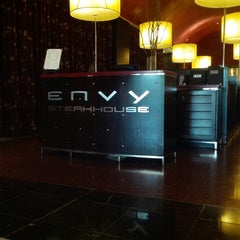 Photo taken at ENVY The Steakhouse by Christian D. on 5/9/2014