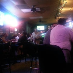 Photo taken at Quinlan's Sports Grill & Bar by Magicc J. on 7/25/2013