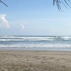 Photo taken at Playa Bonfil by Fernando W. on 6/21/2013