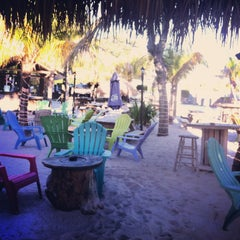 Photo taken at Cruzan Rum Bar by Caitlin C. on 3/27/2013