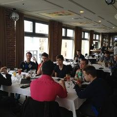 Photo taken at Bravo Brasserie Restaurant by Kevin S. on 2/17/2013