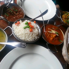 Photo taken at Brick Lane Curry House by Katie O. on 3/25/2013