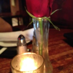 Photo taken at bellini's by Sarah H. on 2/15/2013