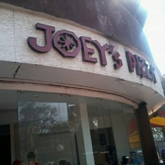 Photo taken at Joey's Pizza by Vikram P. on 12/8/2012