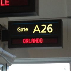 Photo taken at Frontier Airlines (Gates 24 - 32) by Caitlin S. on 7/19/2013