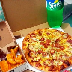 Photo taken at Domino's Pizza by Mei S. on 5/31/2015