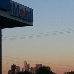 Photo taken at Mobil by Juan H. on 1/31/2013