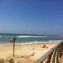 Photo taken at Frishman Beach (חוף פרישמן) by Alyona on 6/12/2013