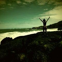 Photo taken at Praia da Ferrugem by Sofia H. on 1/5/2013
