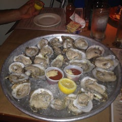 Photo taken at Coast Seafood & Raw Bar by Missa D. on 6/5/2013