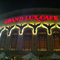 Photo taken at Grand Lux Cafe by Gina C. on 11/22/2012
