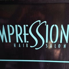 Photo taken at Impressions Hair Salon by Stacie Lee H. on 4/16/2014