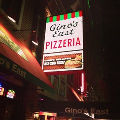 Photo taken at Gino's East by Carlos O. on 2/15/2013