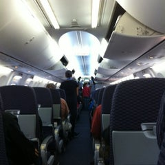Photo taken at Gate 67B by Monica F. on 10/3/2012