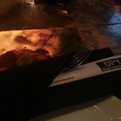 Photo taken at Spy Global Cuisine and Lounge by Michael A. on 11/18/2012