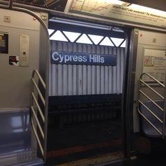 Photo taken at MTA Subway - Cypress Hills (J) by Katie C. on 12/9/2013