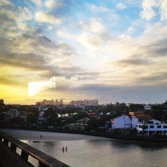 Photo taken at Barra da Tijuca by Thais R. on 11/28/2012