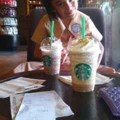 Photo taken at Starbucks Coffee by precy f. on 11/17/2012