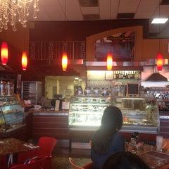 Photo taken at Saquella Cafe by Chris on 6/13/2013