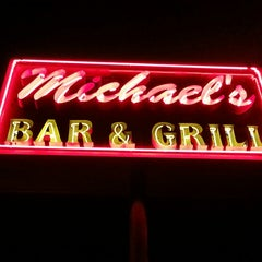 Photo taken at Michael's Bar & Grill by Andrew D. on 12/24/2013