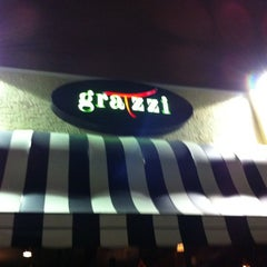 Photo taken at Gratzzi Italian Grille by Daniel F. on 12/19/2012