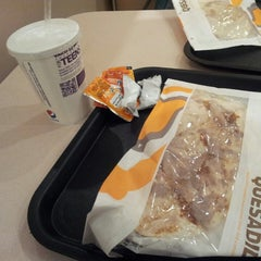 Photo taken at Taco Bell by najlaa a. on 12/30/2013